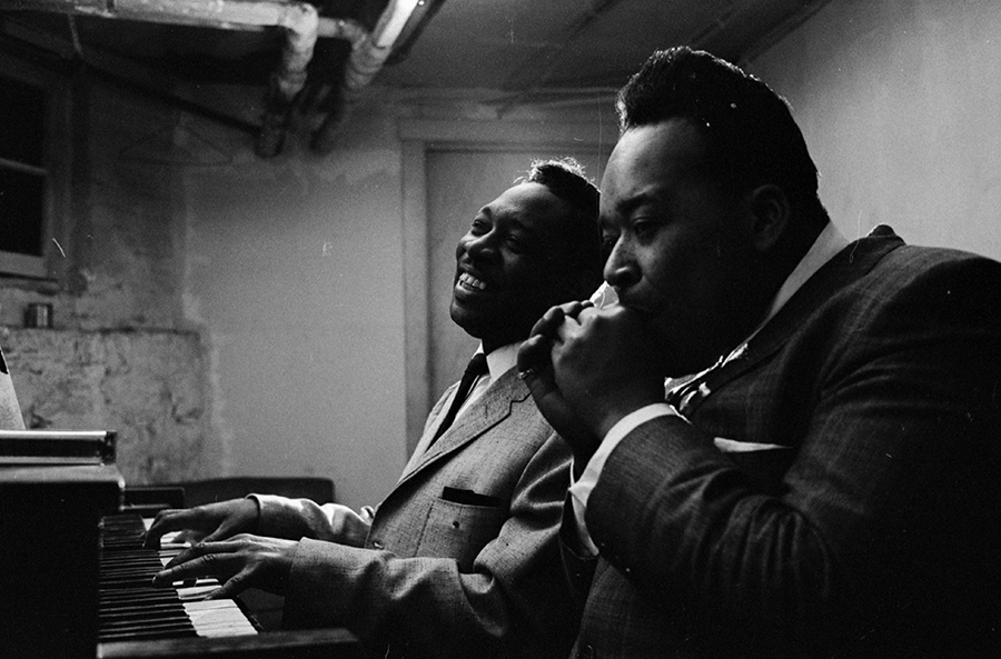 Otis Spann and James Cotton rehearsing in Muddy Waters's basement in Chicago in February 1965