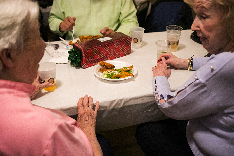 Two friends catch up at the Irish American Heritage Center's Annual Lenten fish fry.
