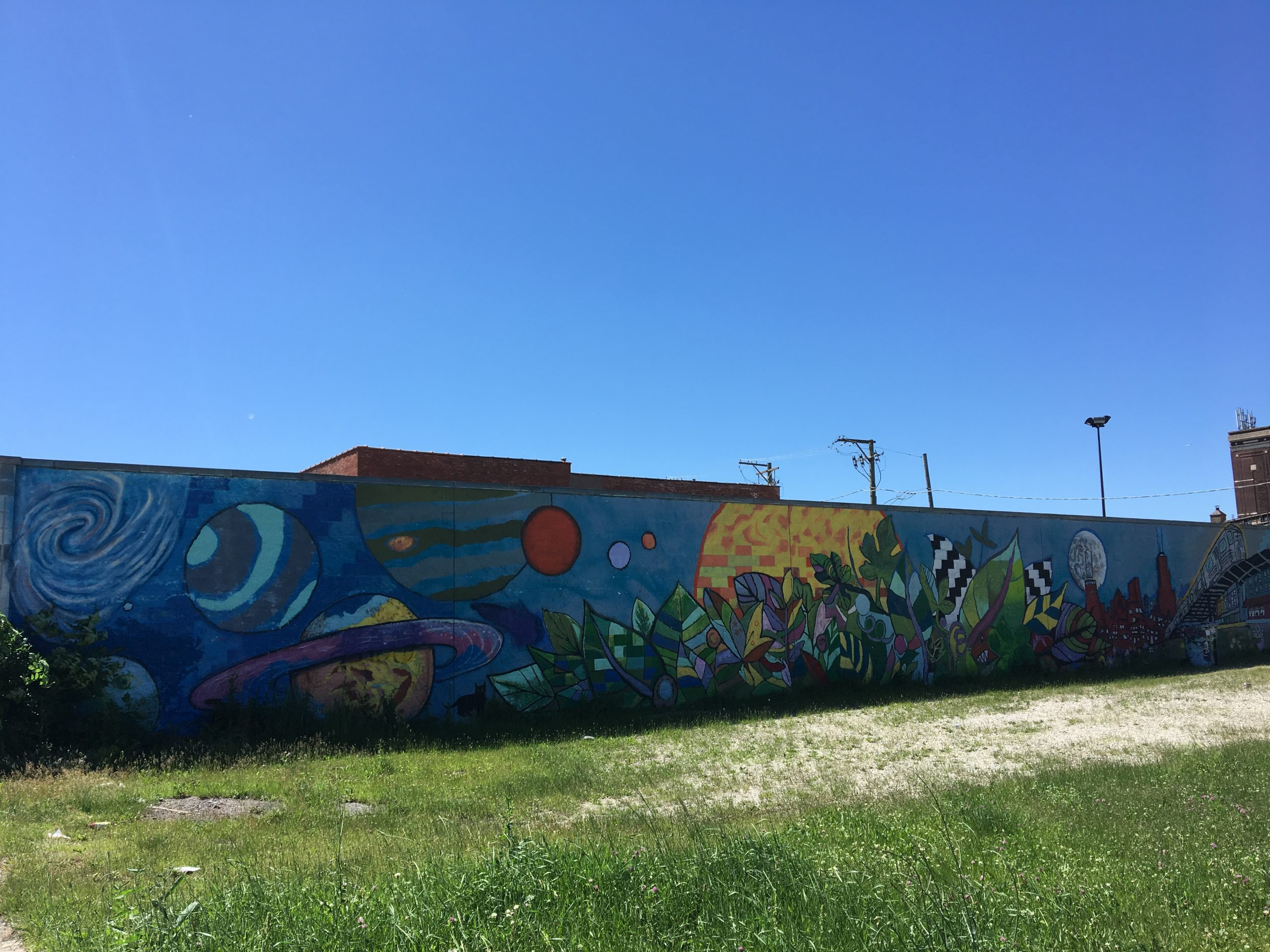 The community mural on Project Logan's eastern wall