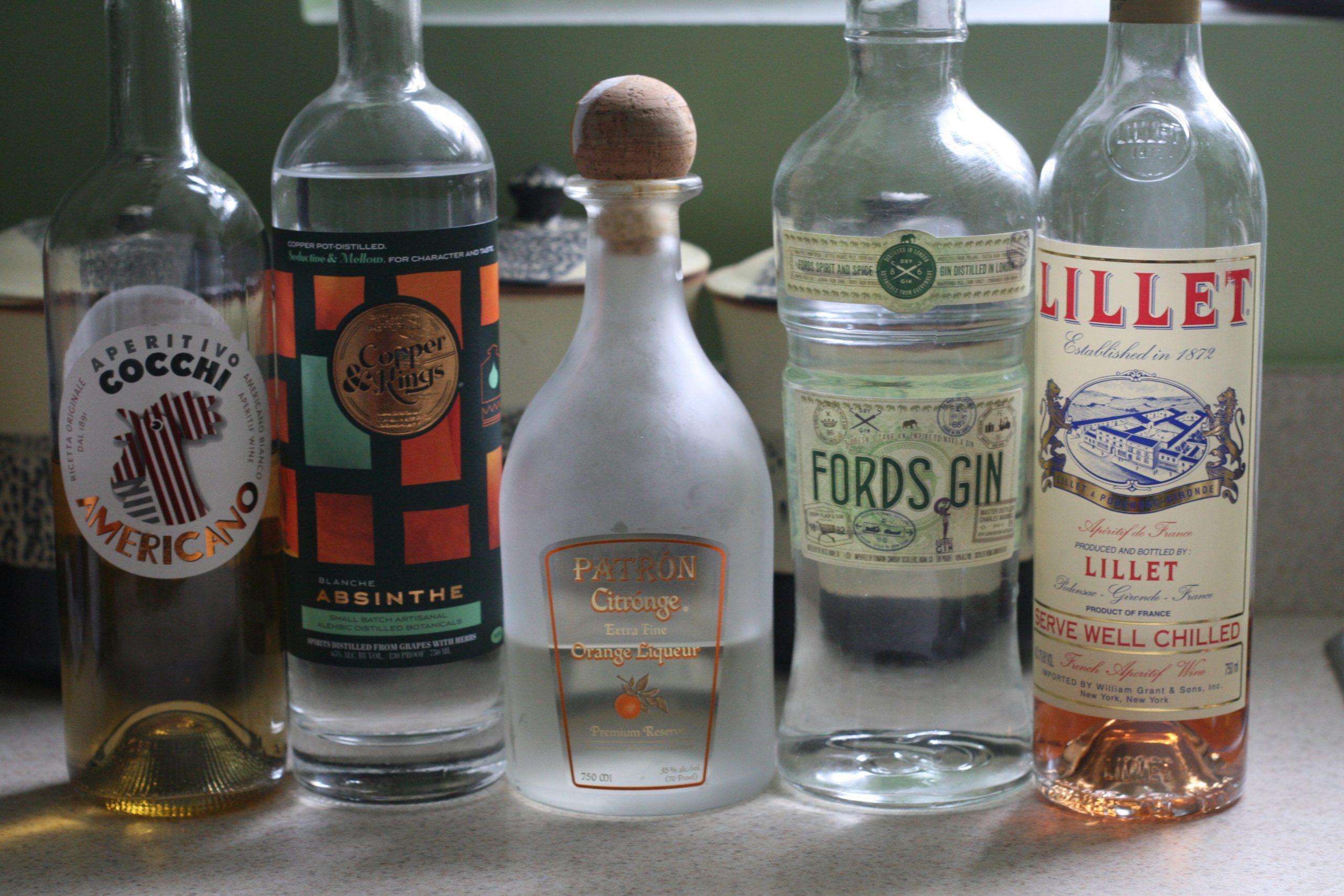 The ingredients for a Corpse Reviver 2 (plus an extra fortified wine)