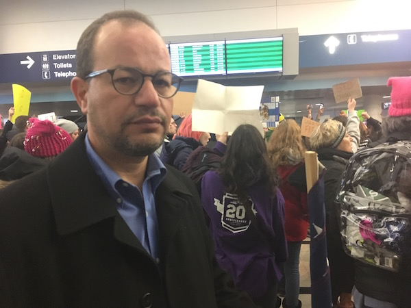 Zaher Sahloul, an American citizen who immigrated to the U.S. from Syria three decades ago, carried an American flag.