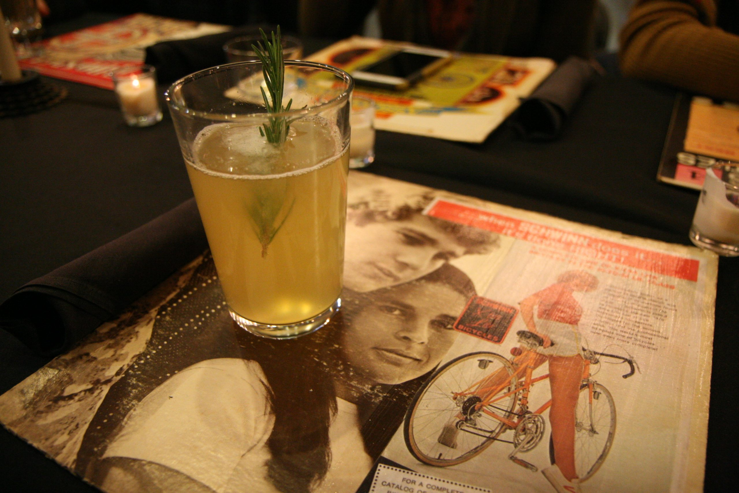 Toolan's radler with rosemary; the placemats were record covers with old Schwinn ads pasted on them.