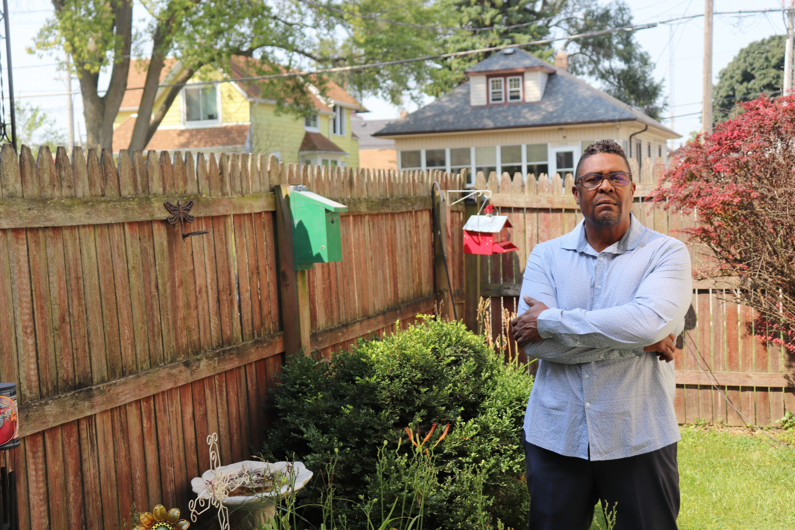Tim Thompkins stands in his backyard in Kenosha on Wednesday, August 26, 2020, less than two miles away from where three protestors were shot the night before.