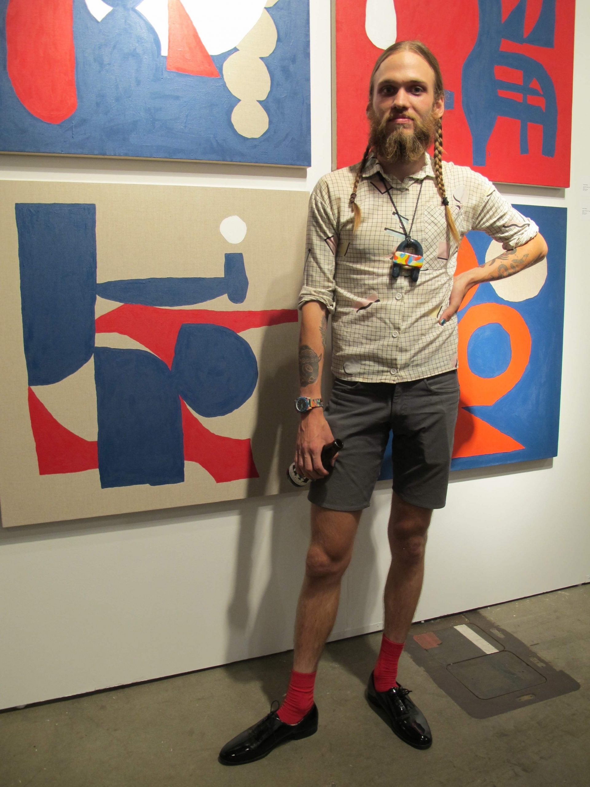 Artist Mike Paro wearing a necklace from his own line, Double Domus, which is sold at Tusk.