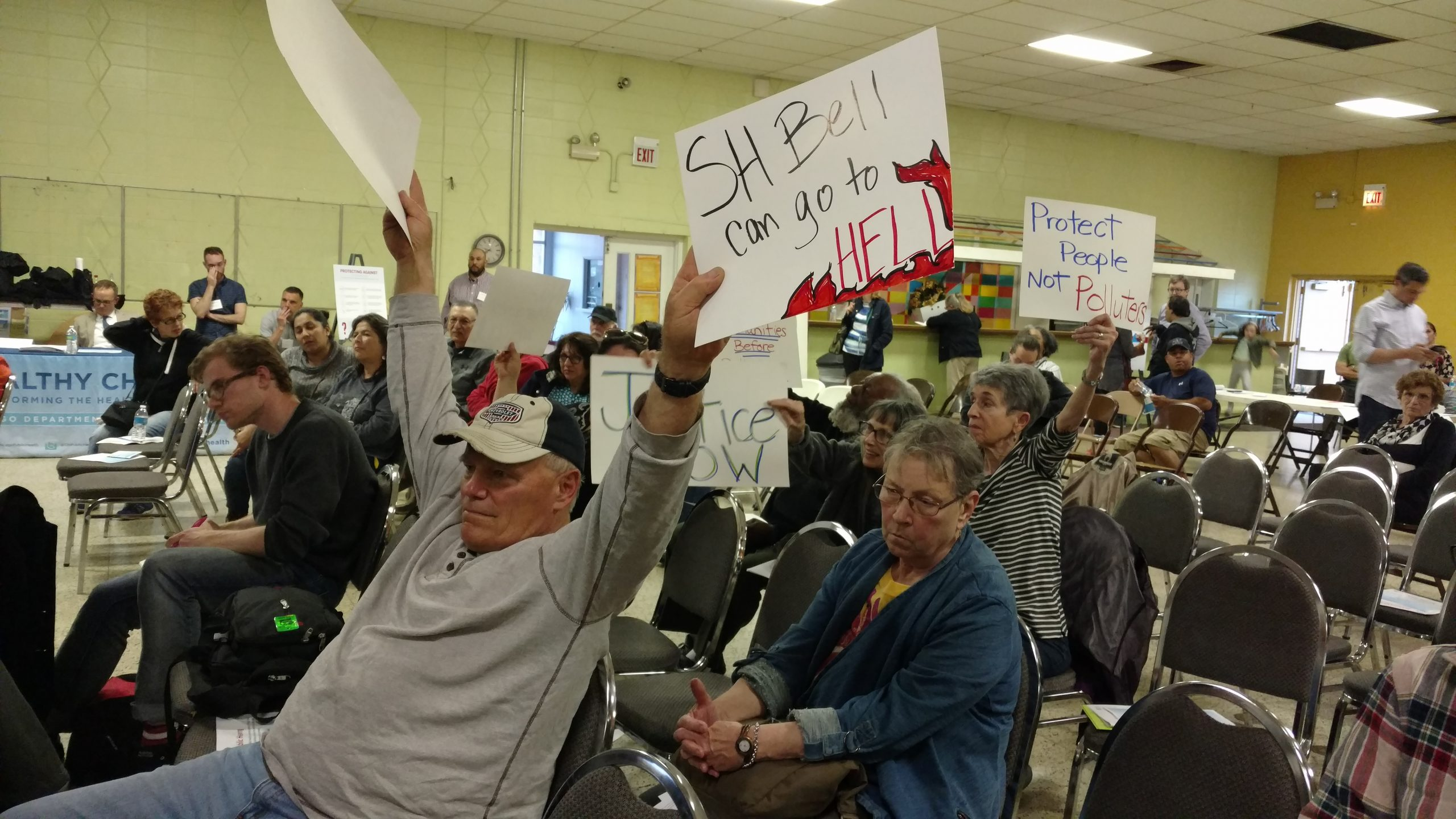 Though the crowd thinned out by the end of the meeting, some residents remained till the end, brandishing homemade signs and calling government officials to shut down S.H. Bell's manganese storage and transportation operations