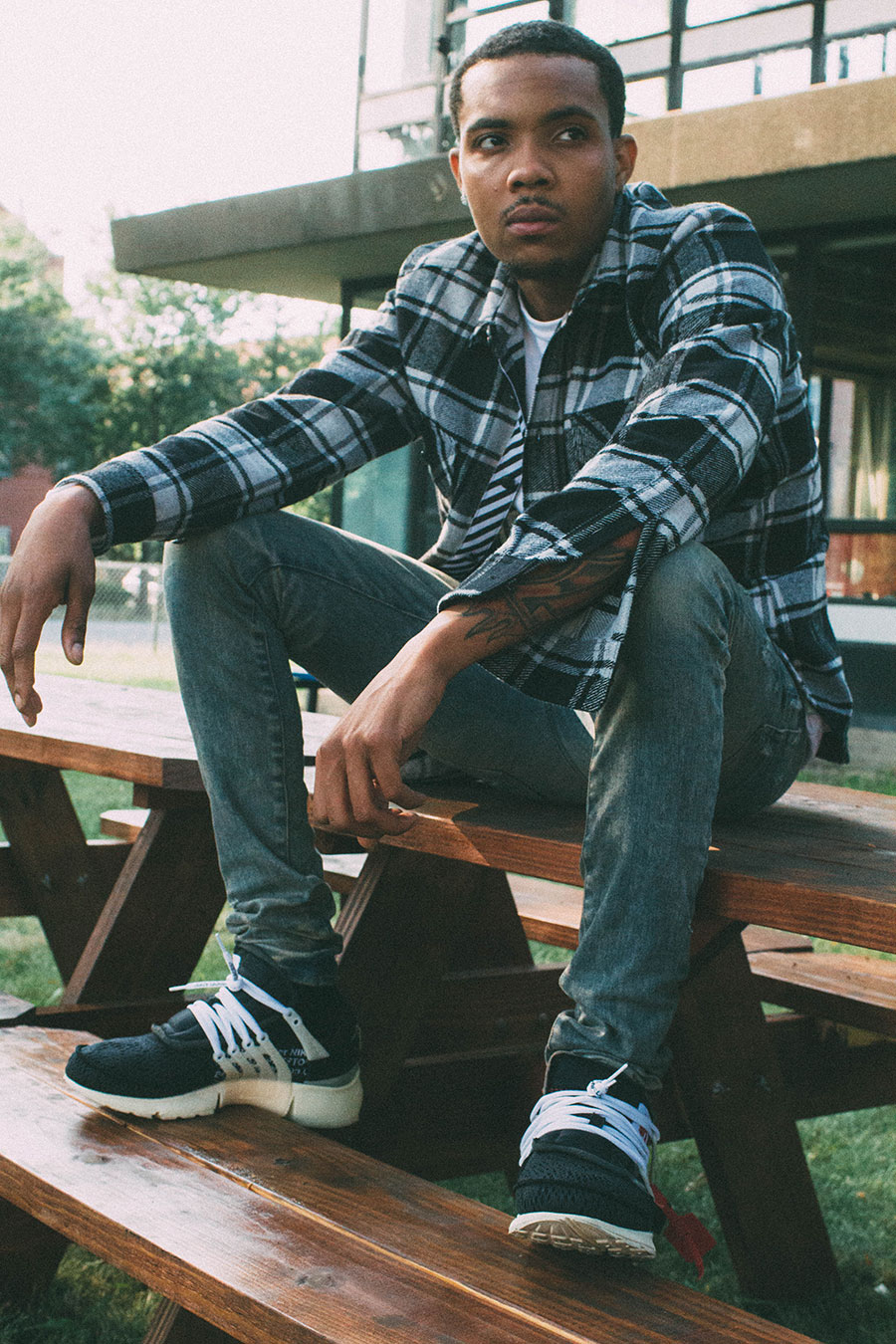 G Herbo in front of Overton Elementary