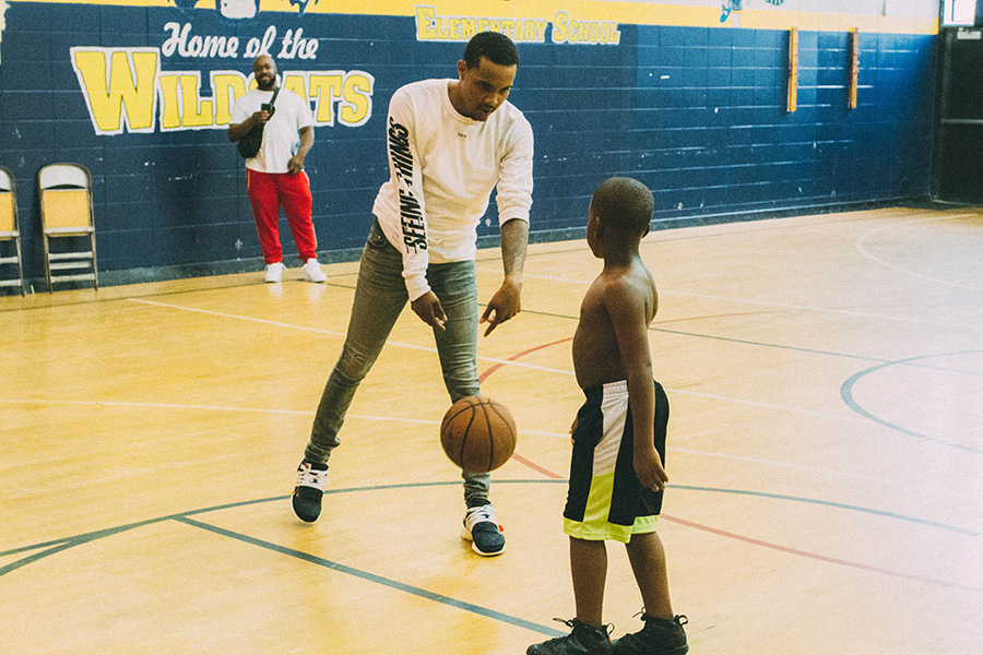 G Herbo and a young boy shoot around in the gym next to Overton Elementary.