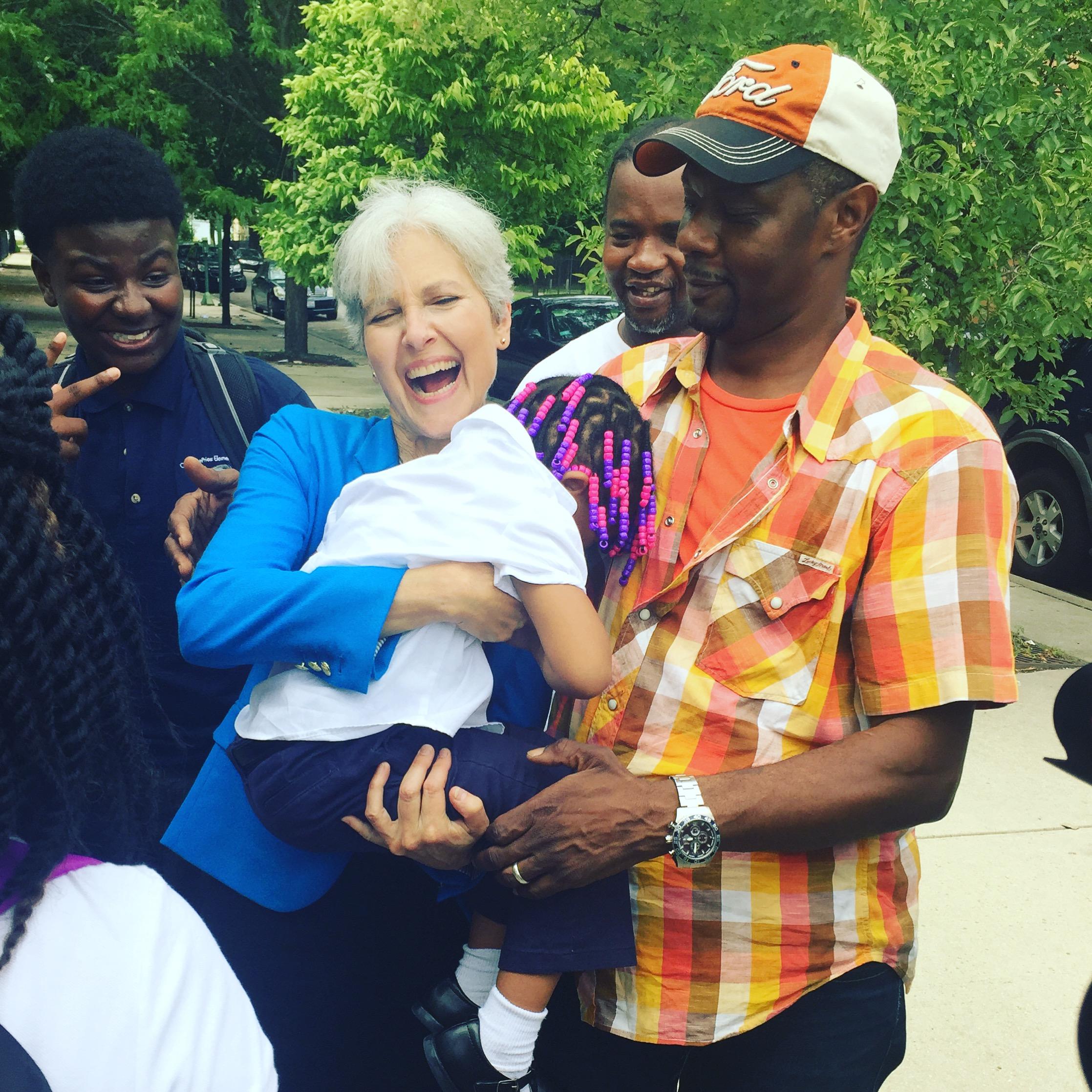 Jill Stein holds the daughter of Austin resident Jonathan Todd.