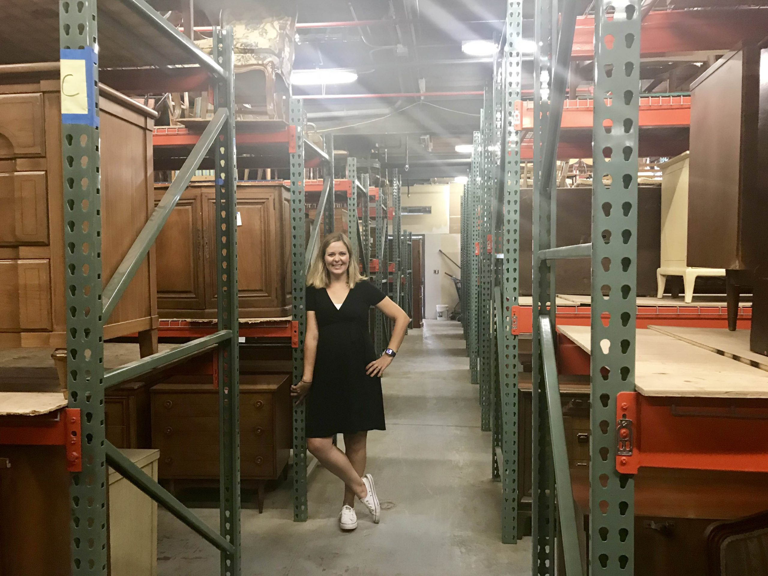Meg Piercy  in the storage room at the new facility