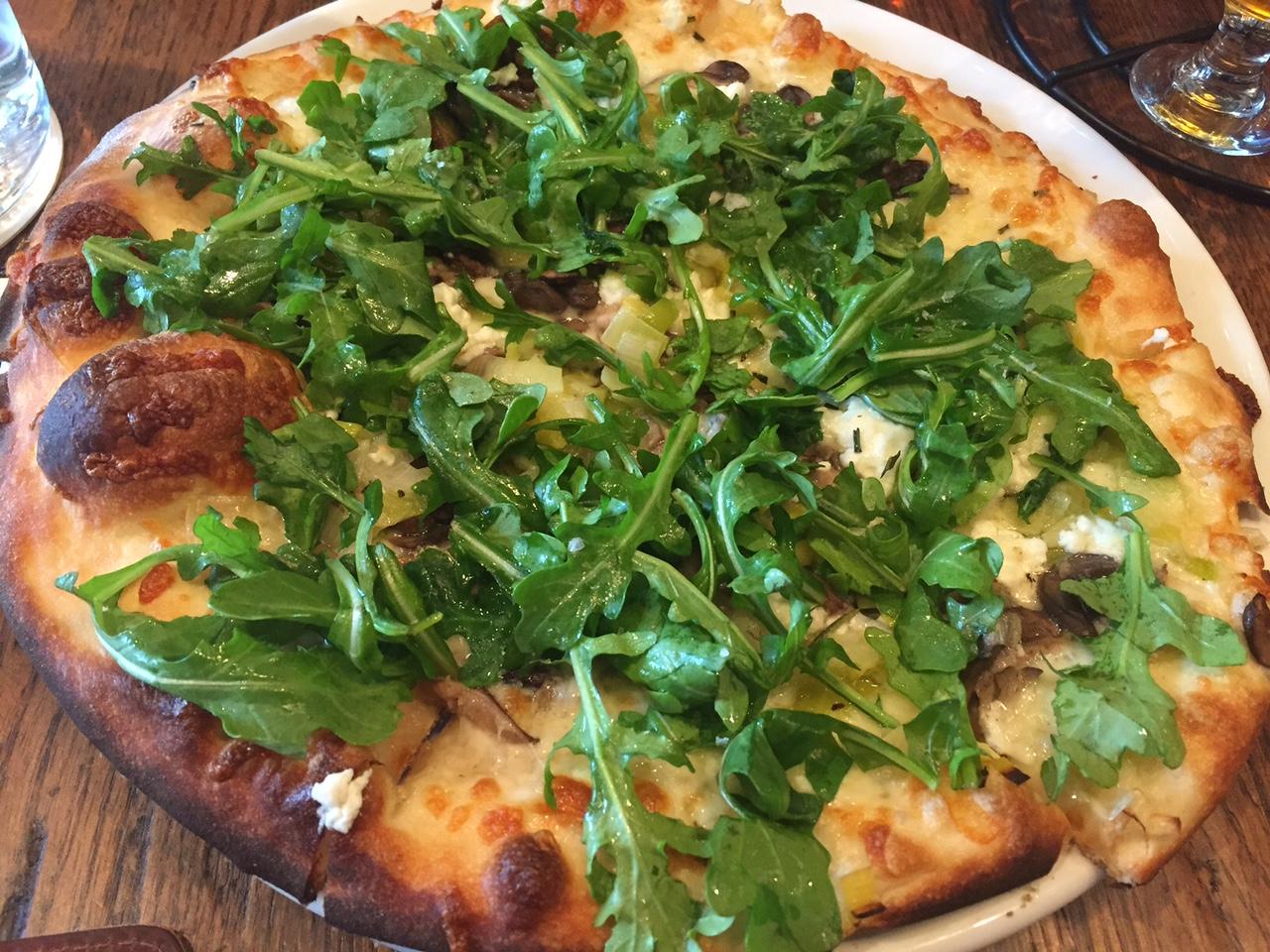 Leek, mushroom, goat cheese, and arugula pizza