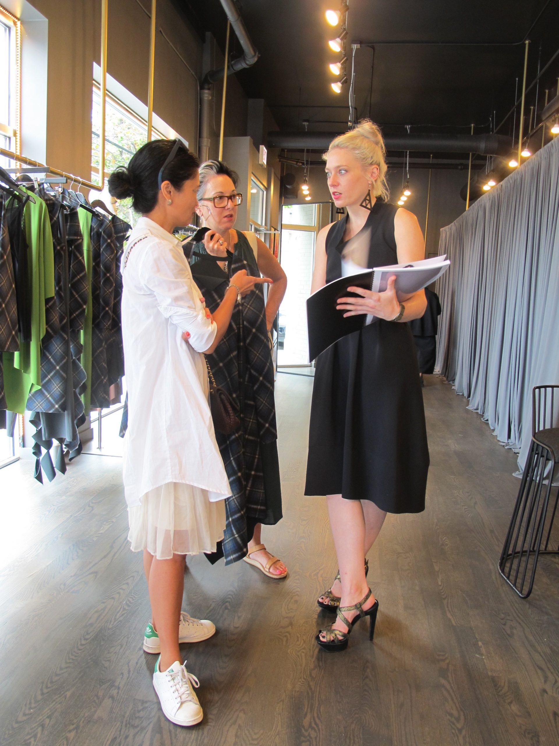 Stylists Arlene Matthews and Brandon Frein learn about the new fall collection.