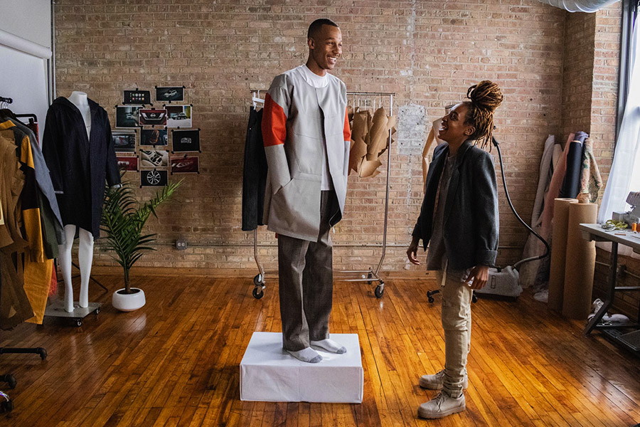 At Sheila Rashid's studio in the Marshall Lofts, she and a model wearing her designs get ready to shoot a Nissan commercial.