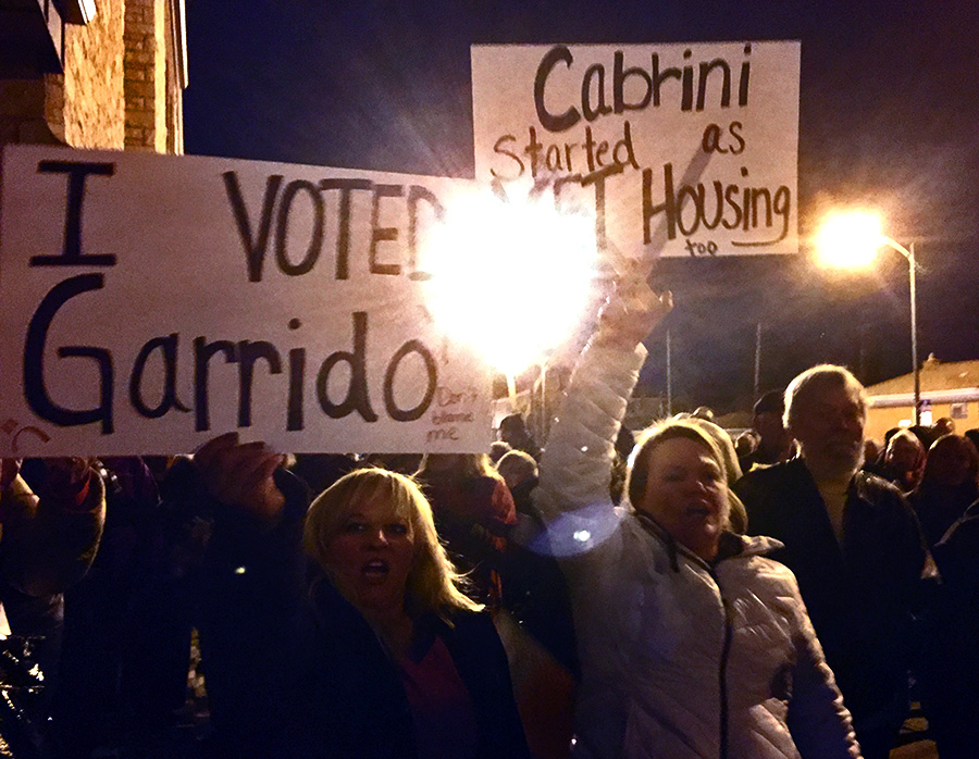 Angry Jefferson Park residents brandished signs supporting Garrido at a protest against a proposed affordable-housing development.