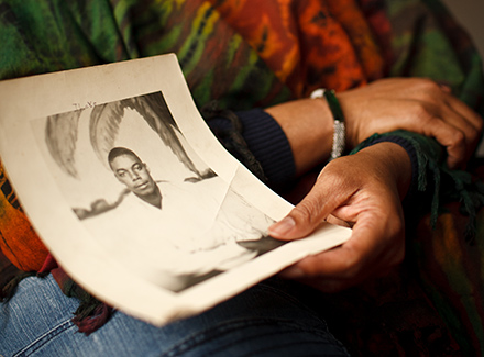 Jo Ann Henson holds one of the few existing photos of her father, who was killed 41 years ago during an altercation with a group of white teenagers.