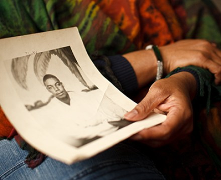 Jo Ann Henson, with a photo of her father, Joe Henson.