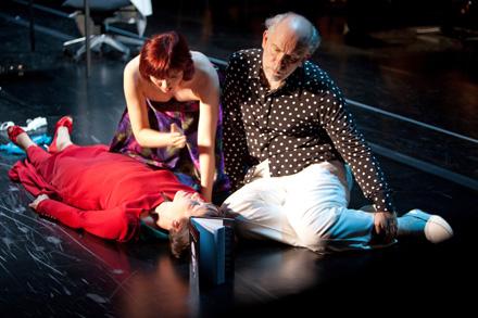 Laura Aikin, Aleksandra Zamojska, and John Malkovich in The Infernal Comedy: Confessions of a Serial Killer