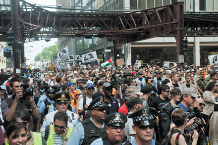 A crowd of war protesters not thinking big picture, like Mayor Emanuel