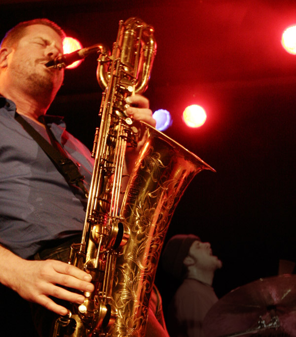 Ken Vandermark does his best to turn a baritone saxophone inside out.