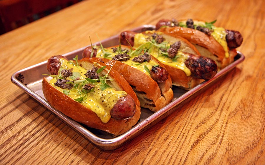 Lamb sausage with chopped cashews, Dijon mustard, Three Floyds Yum Yum pale ale, and lavender leaves, topped with lavender-infused bearnaise
