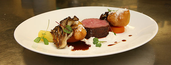 Roasted lamb saddle with lamb sweetbread beignets and roasted lamb fat powder