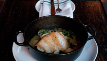 Sea bass <i>en cazuela</i>, bathed in a thin, salty coconut broth spiked weakly with curry