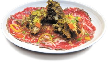 Beef marinated with maguey leaf, garlic, shallots, and chiles, served with tempura-fried maitake mushrooms