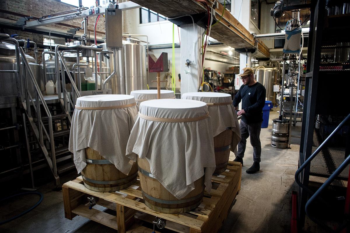 Guzzo moves barrels of Outre Kombucha at Marz Community Brewing.