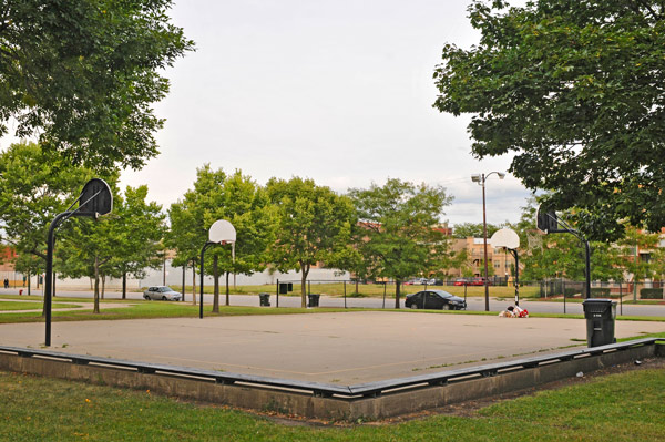 Metcalfe Park, Bronzeville: A community memorial offers tribute to Darius Brown under the hoop were he was shot and killed. Nearly two months after the incident, the courts remain almost unused.