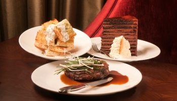 Delmonico steak, ciabatta with Wisconsin blue cheese fondue, 23-layer chocolate cake
