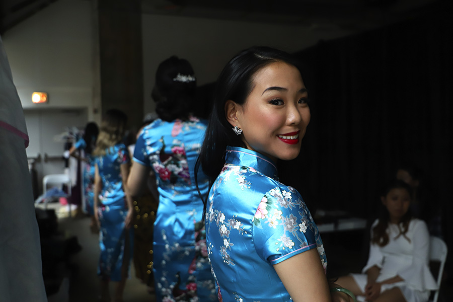 The contestants wait to go onstage in <i>qipao</i>, a traditional Chinese gown.