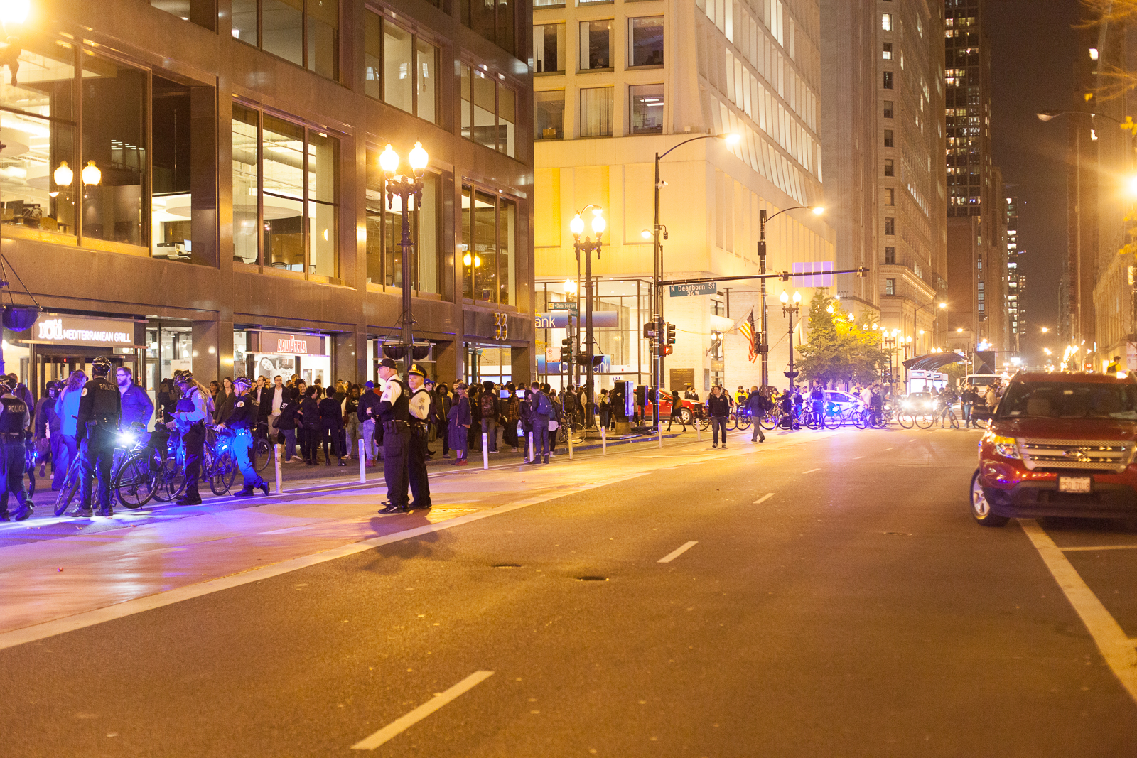 By the time the parade crossed Dearborn, it had spread out enough to fit onto the sidewalk.