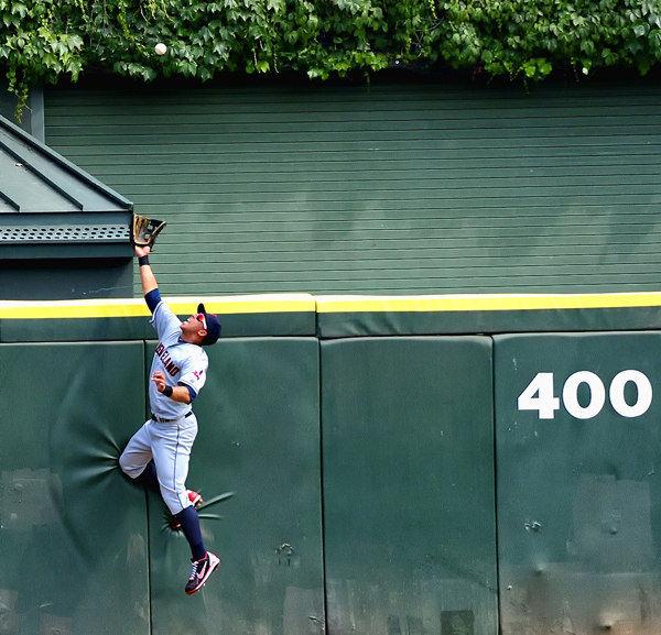 <em>Michael Brantley Robs Alex Rios of a Home Run.</em> US Cellular Field, May. By Paul Boucher