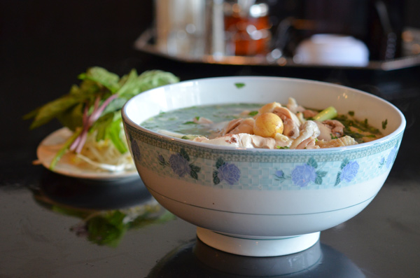 Pho ga features an intensely chickeny broth with herbs, rice noodles, and bone-in bird.