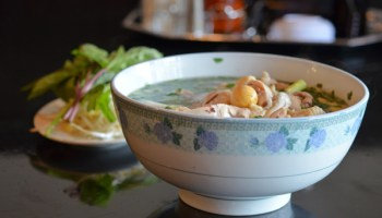 <em>Pho ga</em> features an intensely chickeny broth with herbs, rice noodles, and bone-in bird.