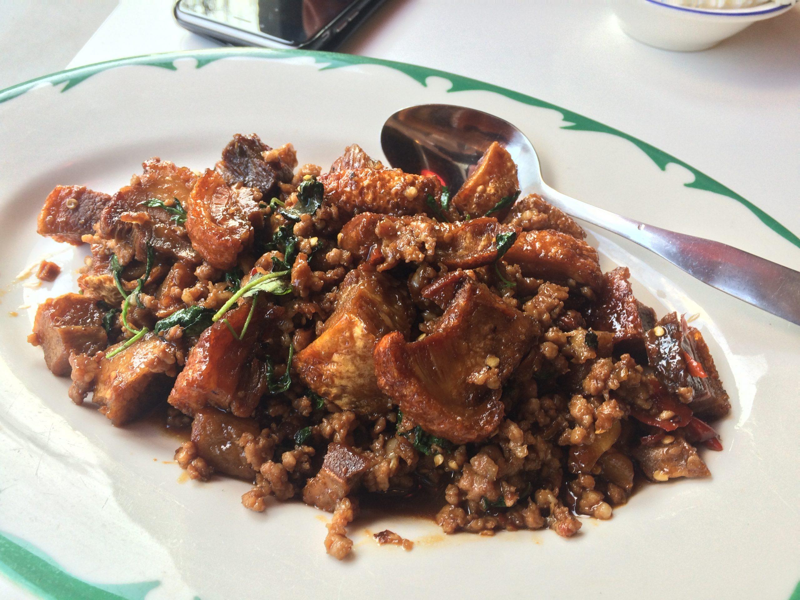 <i>Phat ka-phrao mu krop</i> (spicy basil stir-fry of crispy pork belly) at Tom Yum Cafe