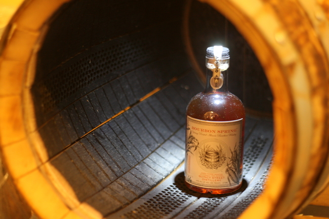 Char on the inside of a barrel at the Quincy Street tasting room (with a bottle of Bourbon Spring whiskey)