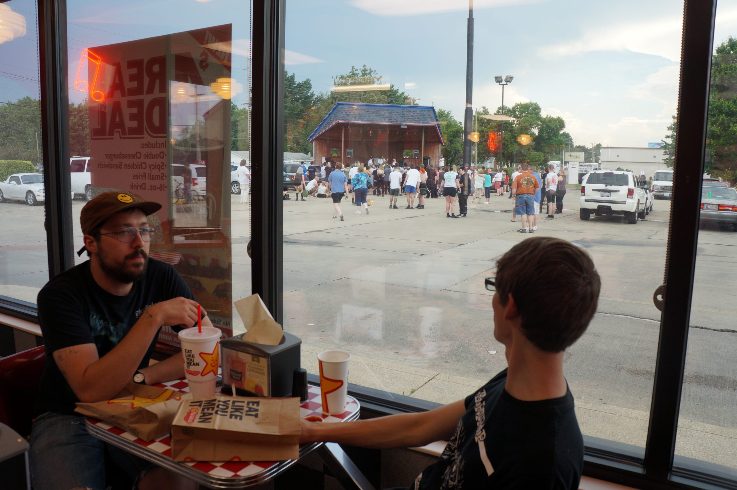 Springfield natives Alistair Reynolds and Drew Kodrich eat inside Rock 'n' Roll Hardee's during the show.