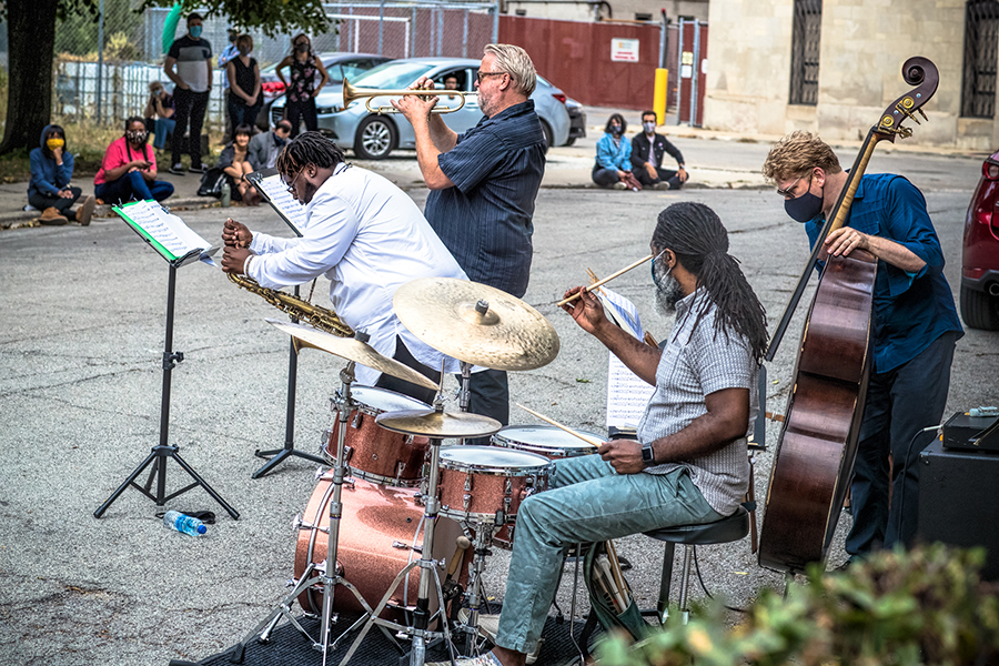 The Russ Johnson Quartet set up near the usual site of the 61st Street Farmers Market.