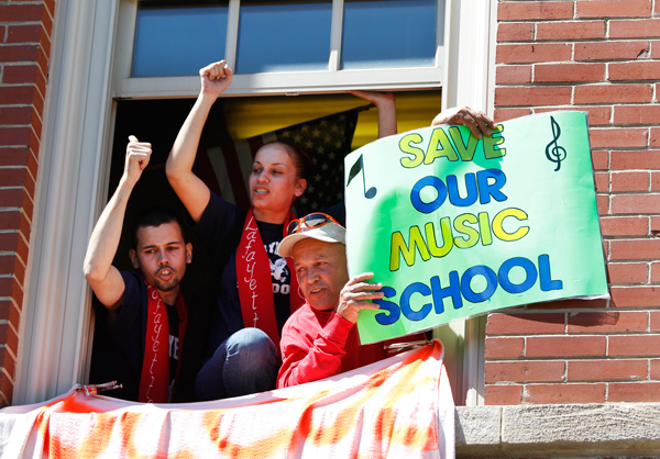 On the last day of classes, demonstrators occupied Jean de Lafayette Elementary School in Humboldt Park to protest its closing next year. Mayor Rahm Emanuel was traveling overseas.