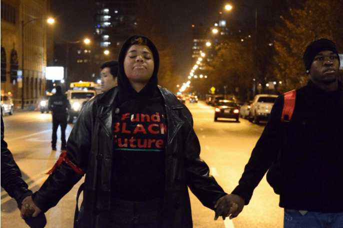 Activists joined hands at Roosevelt and Halsted before marching through the city streets November 24.