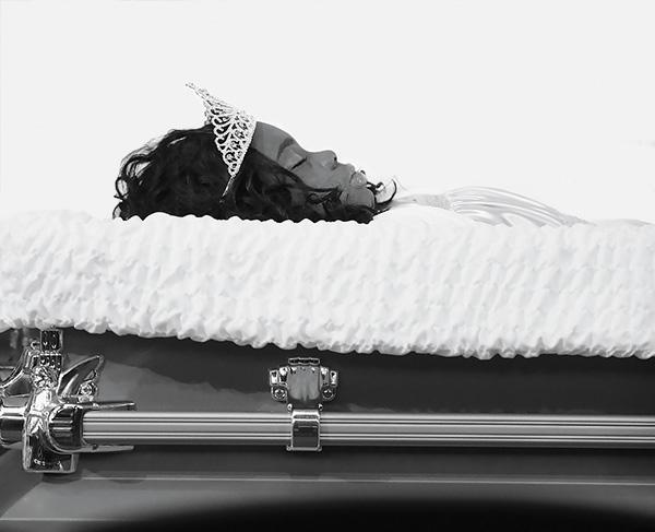 Shamiya Adams lies in rest at a wake at Living Word Christian Center.