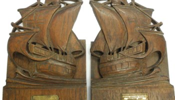 Schroeder's boat-shaped bookends carved from the HMS <i>Warspite</i>