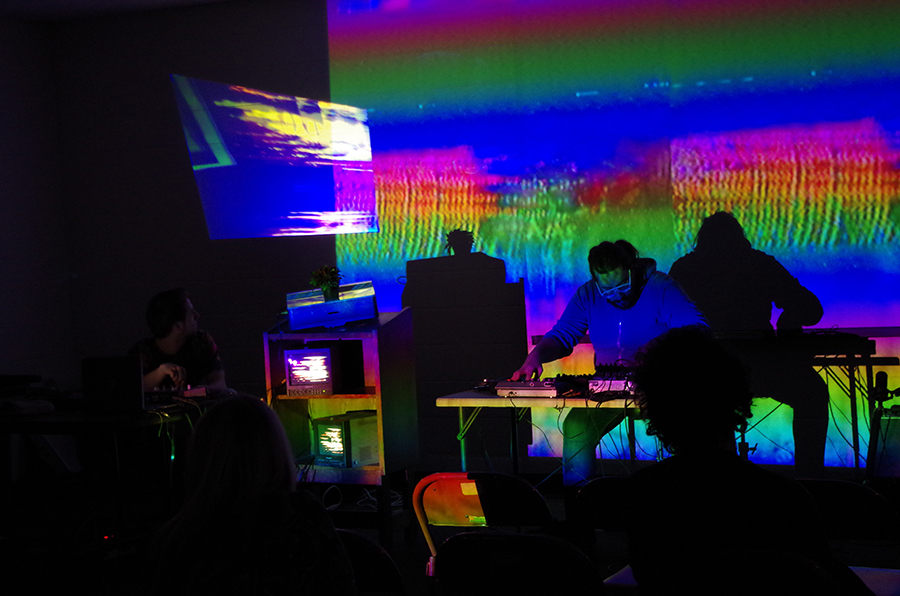 Above: Chicago experimental musicians Jim Jam and Alexander Adams support an April 2018 live performance by Shrine, aka video artist and poet Sara Goodman, at the Jefferson Park branch library.