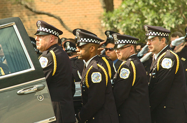 Chicago police officer Robert Soto's casket is placed into a hearse. Soto and a social worker, Kathryn Romberg, were killed in what police believe was a case of mistaken identity.