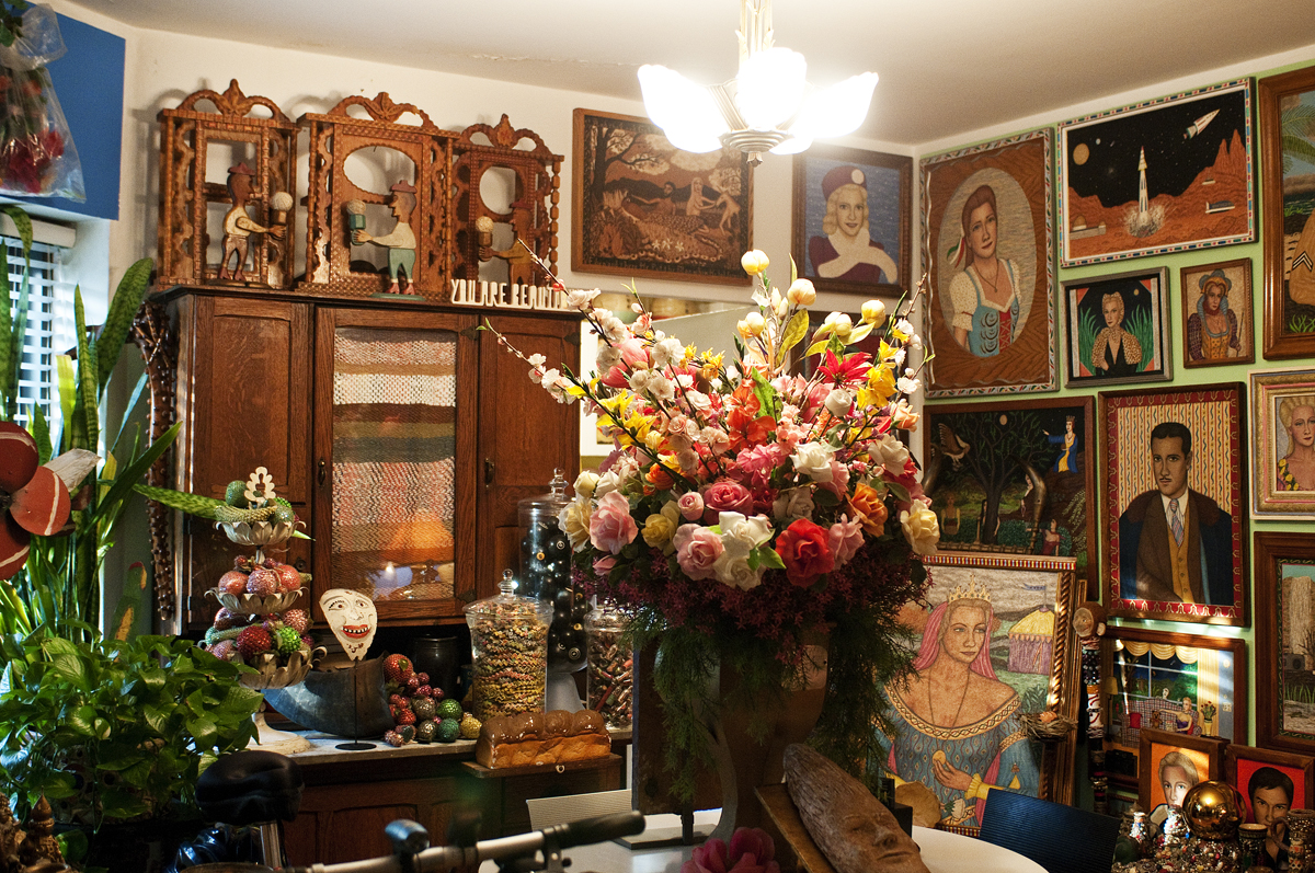 The dining room is home to Sadler's largest collection—paintings by self-taught artist Stephen Warde Anderson.