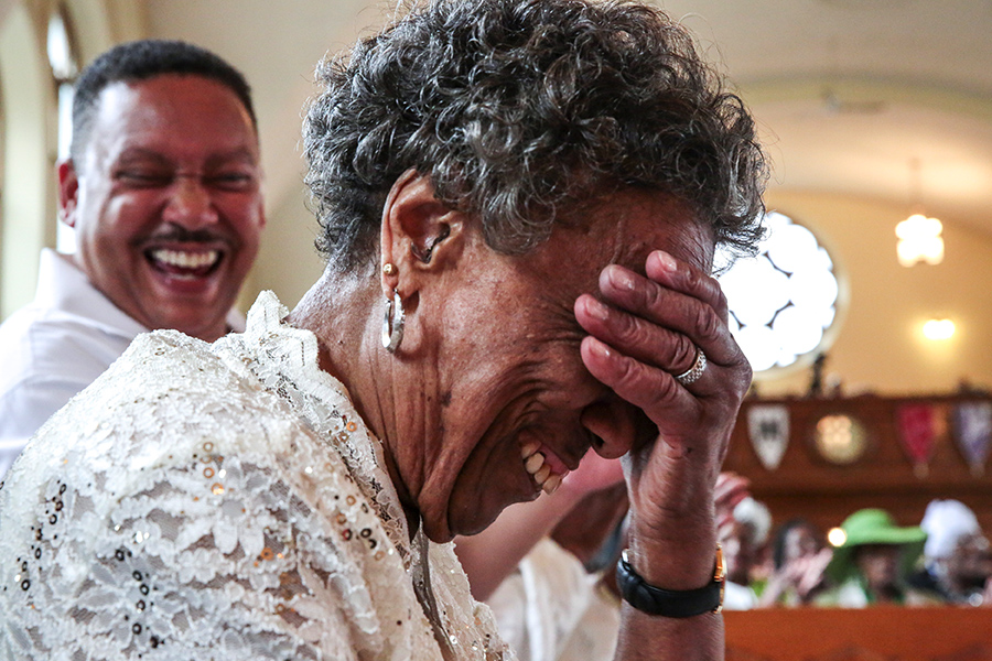 Mama Lou laughs in embarrassment during her 89th birthday party this past July at the Greater Cathedral Tabernacle Church of God in Christ. Her birthday celebration brings together churches and choirs from around the city.