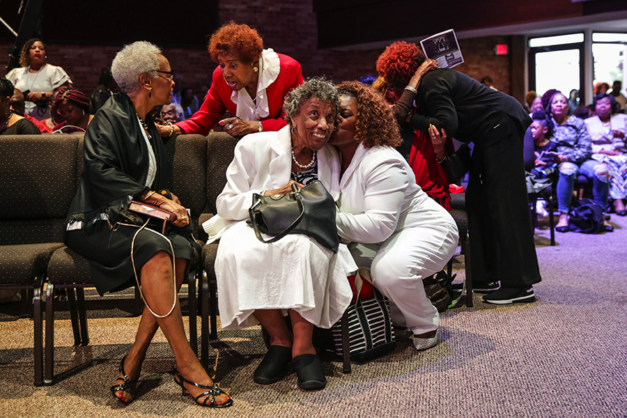 Mama Lou catches up with church members before the 10 AM service at Fellowship Missionary Baptist.