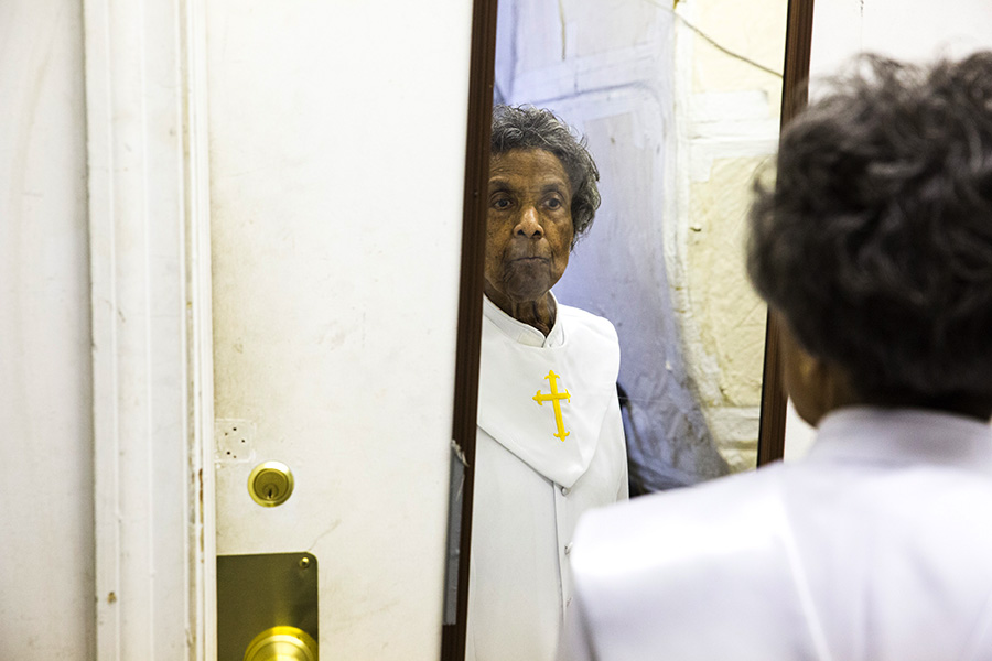 Mama Lou checks herself in the mirror before taking the stage at First Church of Deliverance on Easter Sunday.