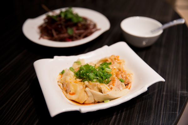 Chengdu-style dumplings bathe in a puddle of lavalike red oil, surprising in its mild sweetness; air-dried beef, in the background, would make a good accompaniment to the restaurant's high-octane rice liquors.