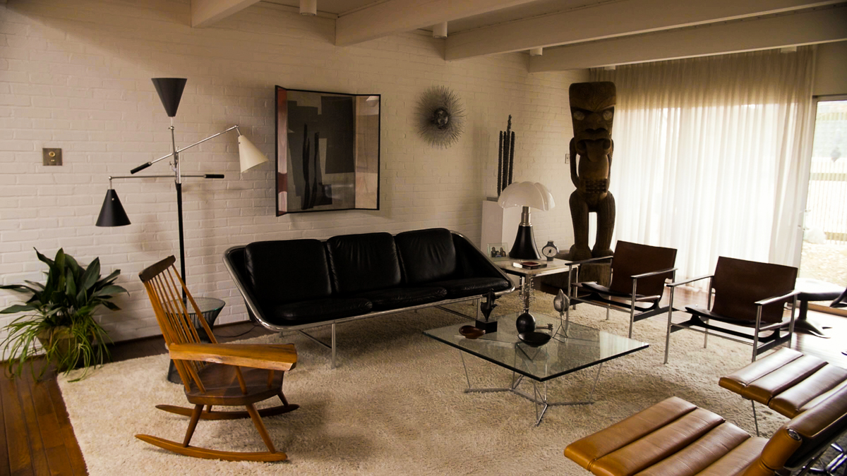"""A view of the Carters' living room. """"We have a few tikis that are too big to fit downstairs,"""" David says."""